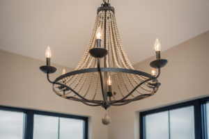 """Magnolia"" – Lakeside Homes New Construction. Detail: chandelier"