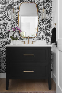 black-and-white-bathroom-bold-wallpaper-brushed-gold-accent-black-cabinet-guest-bath