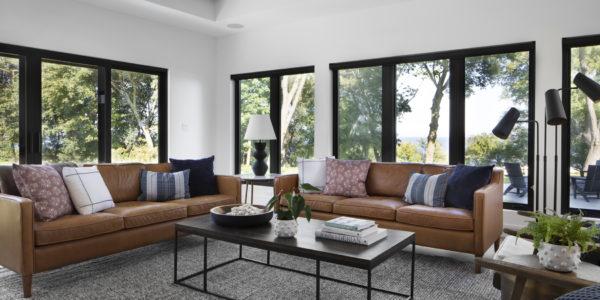 black-windows-modern-open-lakefront-living-room