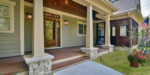 front-door-light-green-home-stone-work-pillars-exterior