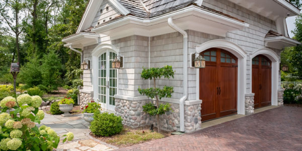 garage-exterior-stone-shingles-square-lighting-brick-driveway