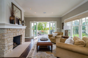 great-room-french-doors-stone-fireplace-natural-light