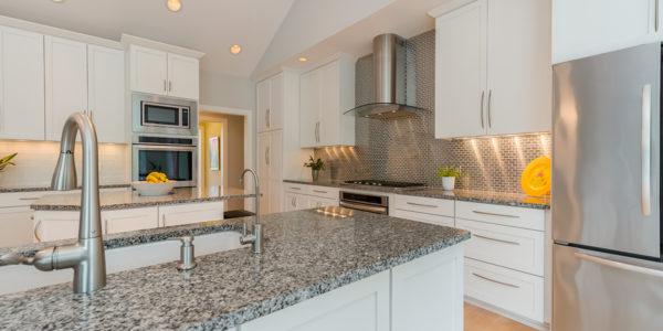 modern-white-kitchen-stainless-steel-appliances-subway-tile-backsplash
