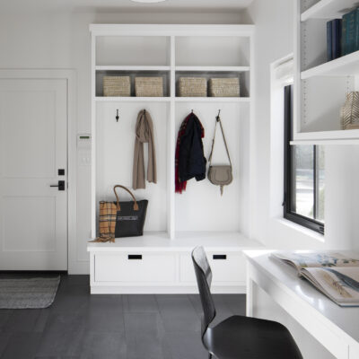 mudroom-storage-utility-room-black-flooring-white-cabinets-built-in-desk