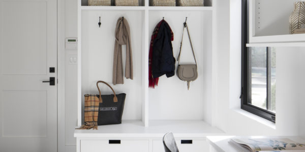 mudroom-storage-utility-room-black-flooring-white-cabinets-built-in-desk