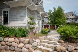natural-gray-shingle-stone-garage-exterior-landscaping