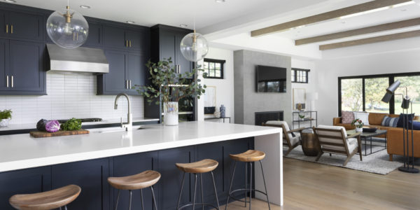 open-concept-kitchen-dark-cabinets-lakefront-home-glass-pendant-lights-brushed-gold
