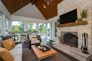 screened-porch-vaulted-ceilings-interior-shingles-stone-fireplace