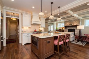 traditional-kitchen-white-cabinets-natural-island-pendant-lighting
