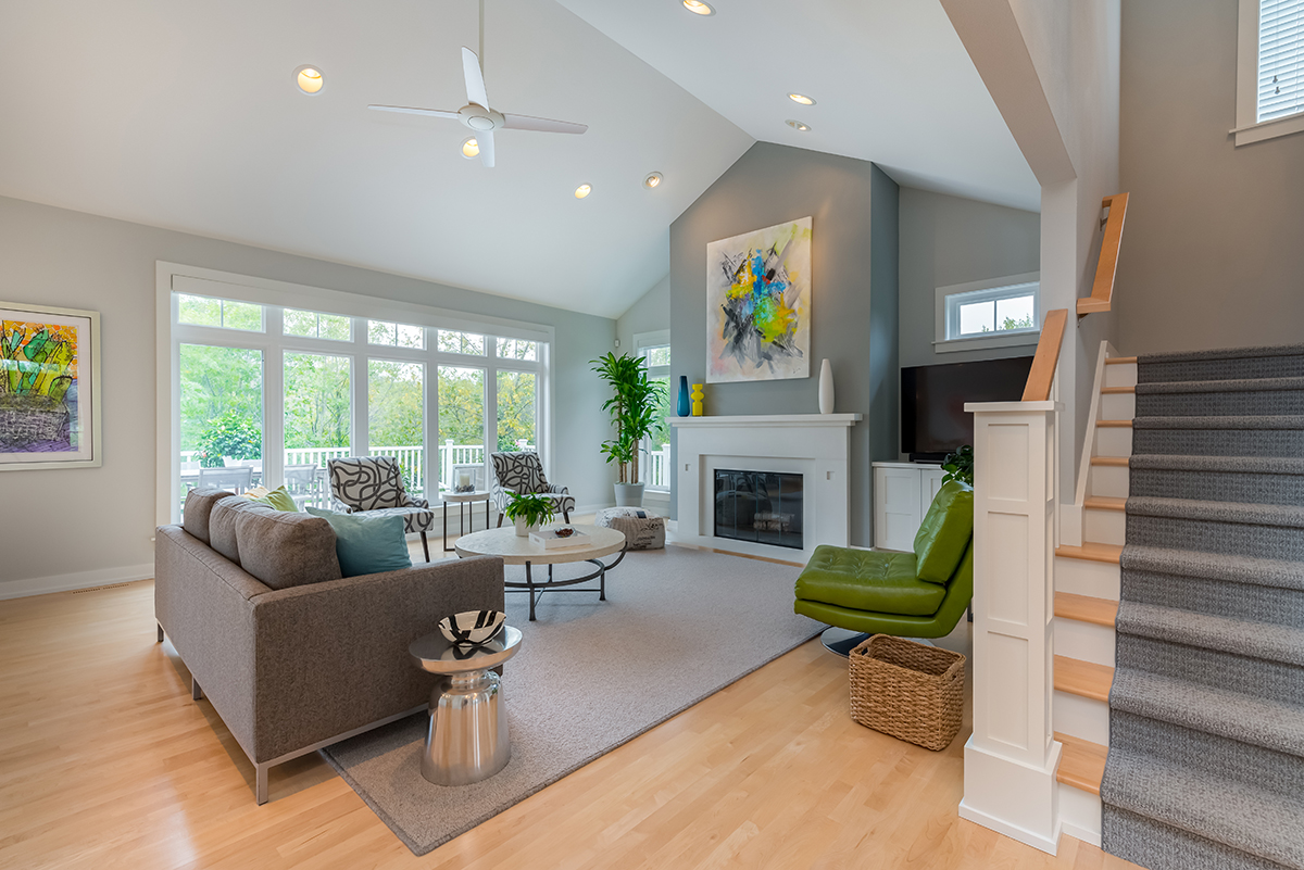 updated-living-room-gray-white-natural-floors-open-concept