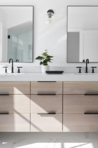 white-bathroom-natural-cabinets-minimalist-clean-matte-black-accents