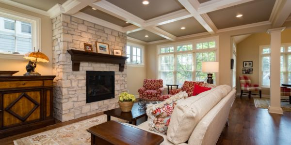 white-beam-ceiling-living-room-stone-fireplace