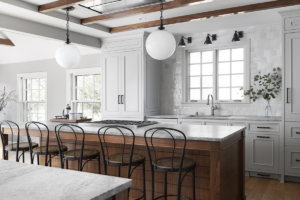 kitchen-remodeling-pendant-lights-wood-beams-island-marble