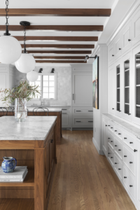 remodeling-kitchen-wood-floors-beams-white-cabinets-marble