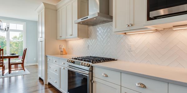 lakeside-white-cabinets-tile-backsplash-kitchen