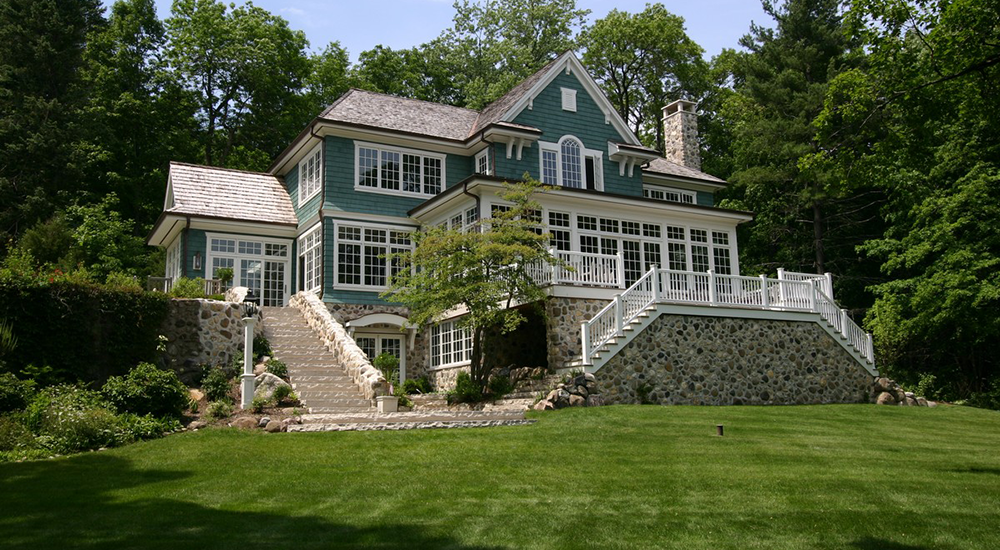 Sophisticated, shingle-style Adirondack-inspired lake cottage in the heart of Lake Country